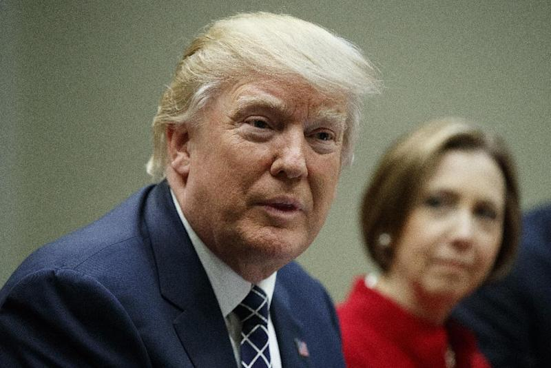 Cape Cod Five Cents Savings Bank CEO Dorothy Savarese listens at right as President Donald Trump meets with leaders from small community banks, Thursday, March 9, 2017, in the Roosevelt Room of the White House in Washington. (AP Photo/Evan Vucci)