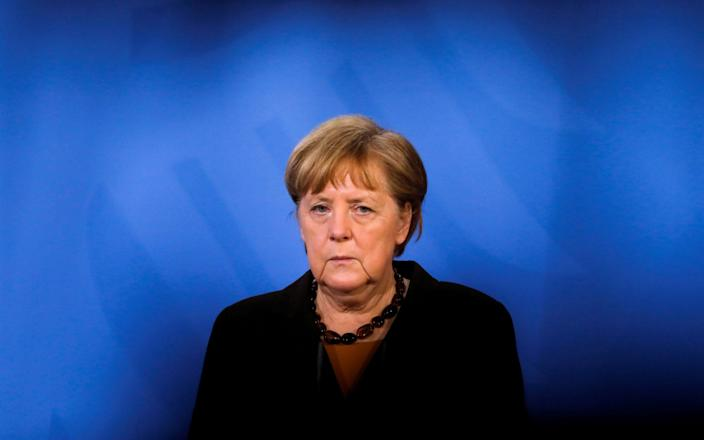 FILE PHOTO: FILE PHOTO: German Chancellor Angela Merkel briefs the media after a virtual meeting with federal state governors at the chancellery in Berlin, Germany, March 30, 2021. Markus Schreiber/Pool via REUTERS/File Photo/File Photo - POOL/REUTERS