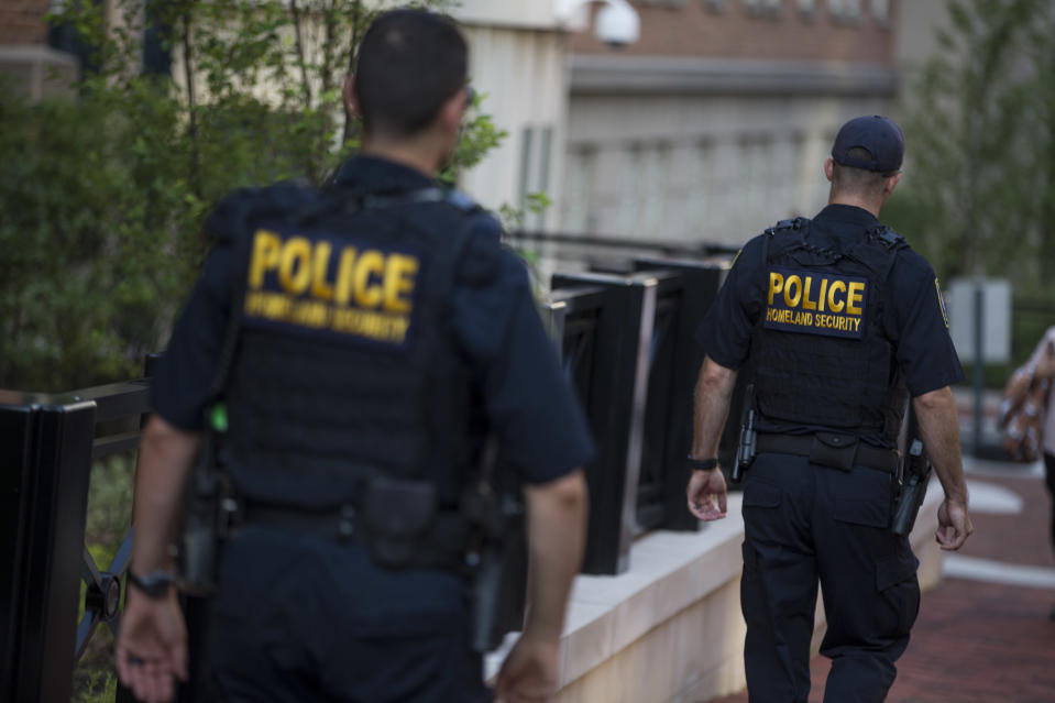 <p>Department of Homeland Security police walk outside of The Albert V. Bryan United States Courthouse before the arrival of former Trump Campaign Manager Paul Manafort on Aug. 7, 2018 in Alexandria, Va. (Photo: Zach Gibson/Getty Images) </p>