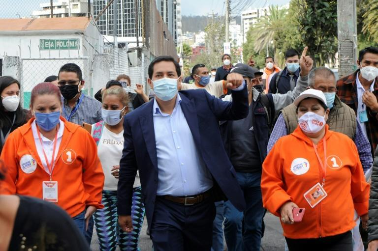 Ecuadoran presidential candidate Andres Arauz (C) greets supporters in Quito on April 6, 2021