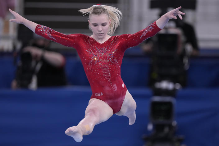 Jade Carey, of the United States, performs on the balance beam during the women's artistic gymnastic qualifications at the 2020 Summer Olympics, Sunday, July 25, 2021, in Tokyo. (AP Photo/Gregory Bull)