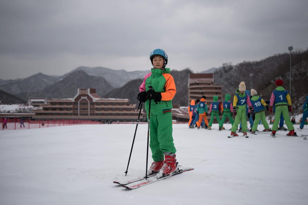 Pak Han-Song, 11, poses for a portrait on a beginner's slope at the Masikryong, or Masik Pass, ski resort near Wonsan. AFP was told that Pak was a member of a youth ski camp.