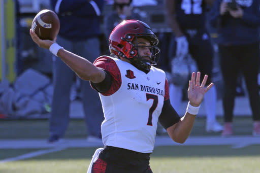 San Diego State quarterback Kaegun Williams throws a first-down pass against Nevada during the first half of an NCAA college football game Saturday, Nov. 21, 2020, in Reno, Nev (AP Photo/Lance Iversen)