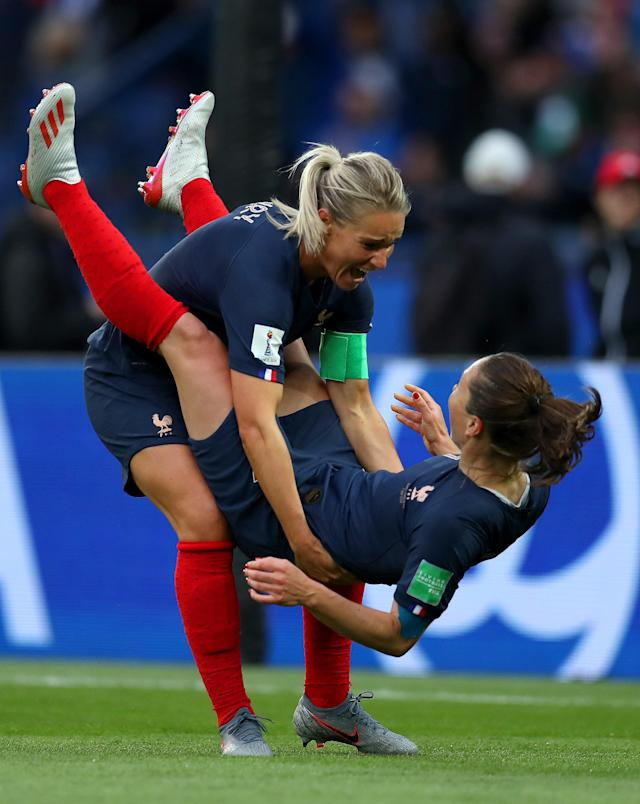 Amandine Henry and Gaetane Thiney of France celebrate following their team's first goal during the 2019 FIFA Women's World Cup France group A match between France and Korea Republic at Parc des Princes on June 07, 2019 in Paris, France. (Photo by Catherine Ivill - FIFA/FIFA via Getty Images)