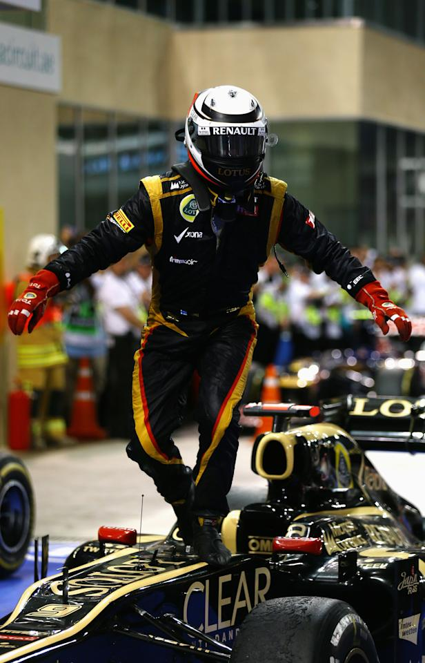 ABU DHABI, UNITED ARAB EMIRATES - NOVEMBER 04:  Kimi Raikkonen of Finland and Lotus celebrates in parc ferme after winning the Abu Dhabi Formula One Grand Prix at the Yas Marina Circuit on November 4, 2012 in Abu Dhabi, United Arab Emirates.  (Photo by Paul Gilham/Getty Images)