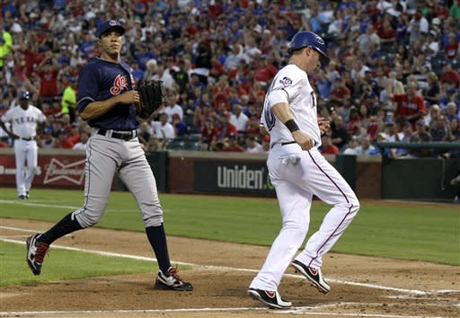Cleveland Indians' Ubaldo Jimenez watches as Texas Rangers' Michael Young scores on a wild pitch by Jimenez in the second inning of a baseball game Tuesday, Sept. 11, 2012, in Arlington, Texas. (AP Photo/Tony Gutierrez)