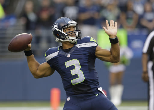 Seattle Seahawks starting quarterback Russell Wilson passes against the Oakland Raiders in the first half of an NFL preseason football game on Thursday, Aug. 29, 2013, in Seattle. (AP Photo/Elaine Thompson)