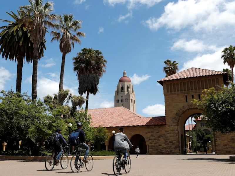 Cyclists traverse the main quad on Stanford University's campus in Stanford California.JPG