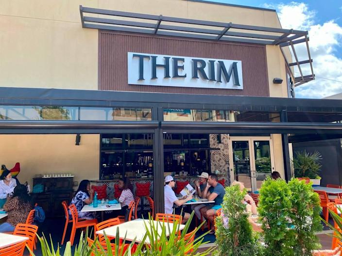 The patio at the Rim faces the Grove at Waterside, the shopping center courtyard.