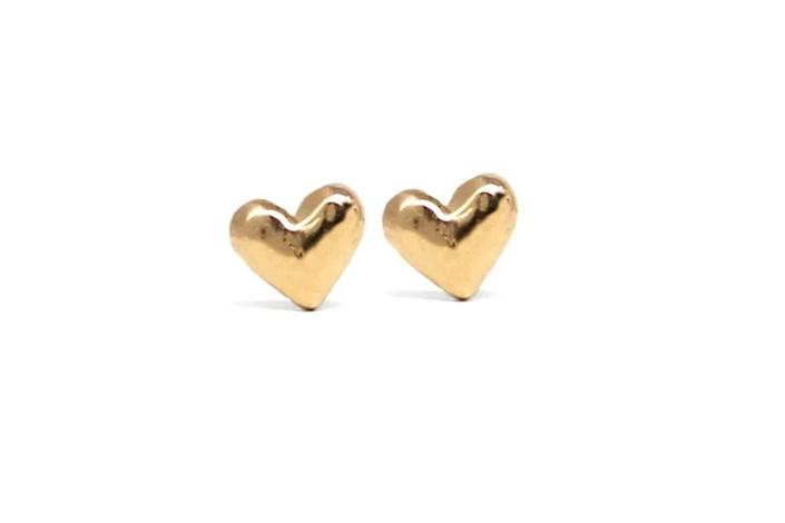 """<p>Who says you need a significant other to get jewelry on Valentine's Day? These cute heart studs from Blooming Lotus are cute enough to wear all year round! </p> <p><strong>Buy It! </strong>Heart Stud Earrings, $78; <a href=""""https://www.bloominglotusjewelry.com/collections/stud-earrings/products/heart-stud-earrings-solid-14k-gold"""" rel=""""sponsored noopener"""" target=""""_blank"""" data-ylk=""""slk:bloominglotusjewelry.com"""" class=""""link rapid-noclick-resp"""">bloominglotusjewelry.com</a></p>"""