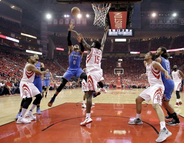 "<a class=""link rapid-noclick-resp"" href=""/nba/players/4390/"" data-ylk=""slk:Russell Westbrook"">Russell Westbrook</a> attacks the Rockets defense. (AP)"