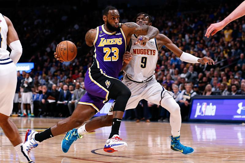 Feb 12, 2020; Denver, Colorado, USA; Los Angeles Lakers forward LeBron James (23) drives to the net against Denver Nuggets forward Jerami Grant (9) in the second quarter at the Pepsi Center. Mandatory Credit: Isaiah J. Downing-USA TODAY Sports