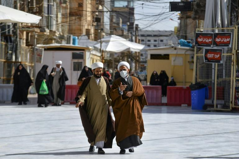 Iraqi clerics wearing protective masks in the holy city of Najaf, where Iraq's first novel coronavirus infection was confirmed