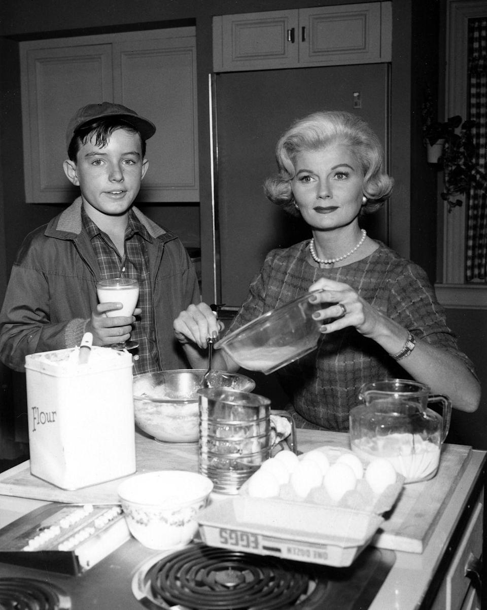 <p>June Cleaver's spotless kitchen on the beloved sitcom was a central gathering place for her wholesome family. The picture-perfect mother and wife regularly washed dishes wearing heels and pearls.</p>