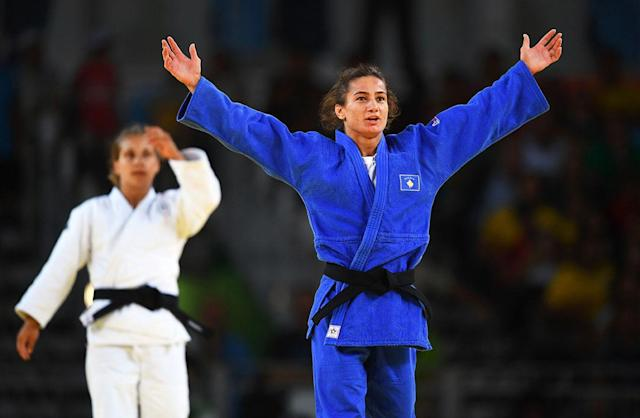 <p>Majlinda Kelmendi of Kosovo celebrates winning the gold medal as Odette Giuffrida of Italy looks dejected during the Women's -52kg gold medal final on Day 2 of the Rio 2016 Olympic Games at Carioca Arena 2 on August 7, 2016 in Rio de Janeiro, Brazil. (Photo by Laurence Griffiths/Getty Images) </p>