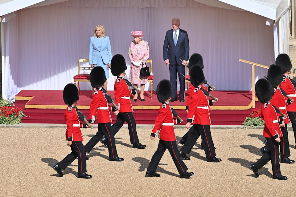 WINDSOR, ENGLAND - JUNE 13: Queen Elizabeth II (C), US President Joe Biden (R) and US First Lady Dr Jill Biden (L) at Windsor Castle on June 13, 2021 in Windsor, England.  Queen Elizabeth II hosts US President, Joe Biden and First Lady Dr Jill Biden at Windsor Castle. The President arrived from Cornwall where he attended the G7 Leader's Summit and will travel on to Brussels for a meeting of NATO Allies and later in the week he will meet President of Russia, Vladimir Putin. (Photo by Samir Hussein - Pool/WireImage)