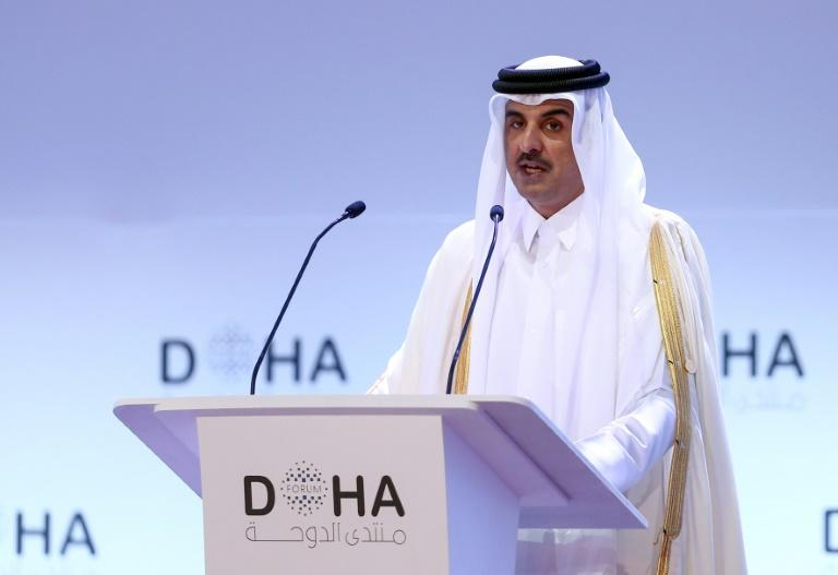 A file picture taken on December 14, 2019 shows the Emir of Qatar Sheikh Tamim bin Hamad al-Thani delivering a speech during the opening session of the Doha Forum in the Qatari capital