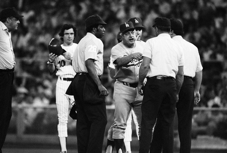Phillies' Larry Bowa stands on first base as he watches Los Angeles Dodgers' manager Tom Lasorda argue with the umpires in the third inning of game, Friday, June 3, 1978 (AP Phot/Rusty Kennedy)