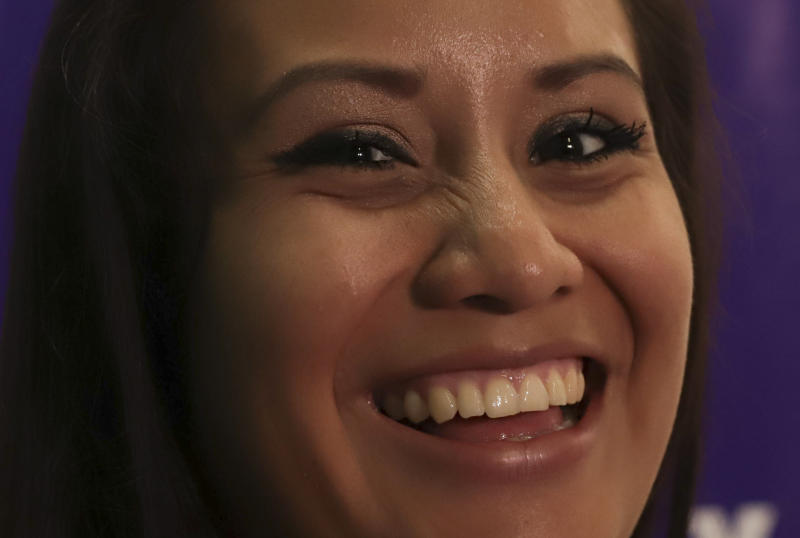 """Evelyn Beatriz Hernandez, a 21-year-old Salvadoran woman who was originally sentenced to 30 years in prison for aggravated homicide after suffering a miscarriage in 2016, smiles as she answers questions from journalists two days after her acquittal on retrial, at the offices of Colectivo Feminista in San Salvador, El Salvador, Wednesday, Aug. 21, 2019. Hernandez, who spent nearly three years in jail, said Wednesday """"Now that I'm free, I feel like I've come back to life."""" (AP Photo/Salvador Melendez)"""