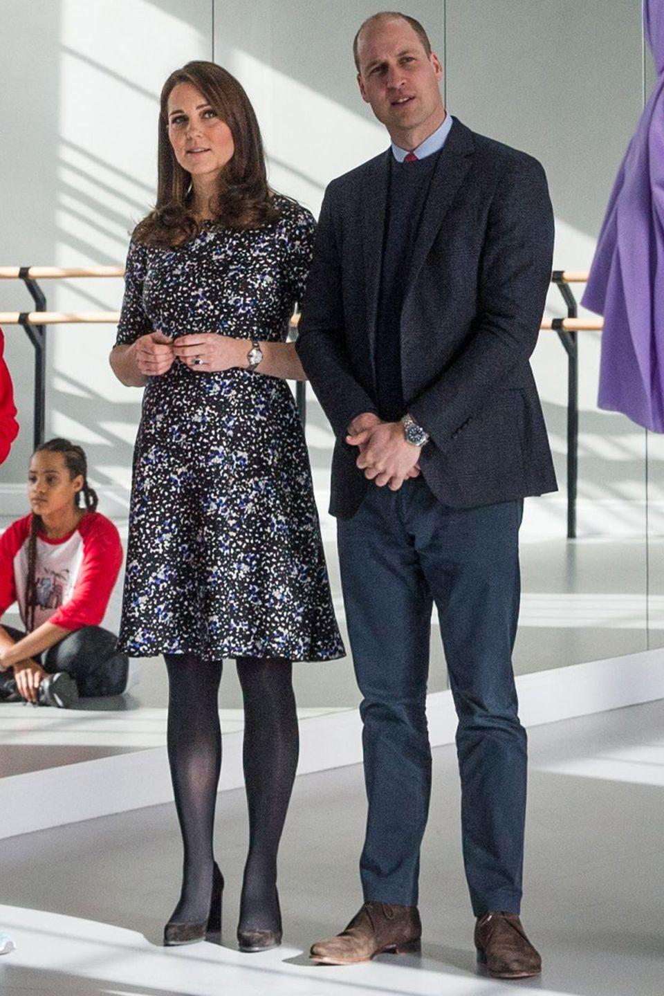<p>Wearing a black-and-white printed long-sleeved dress, with silver jewelry, black tights, and heels while at the Fire Station Arts Centre in Sunderland with Prince William.</p>