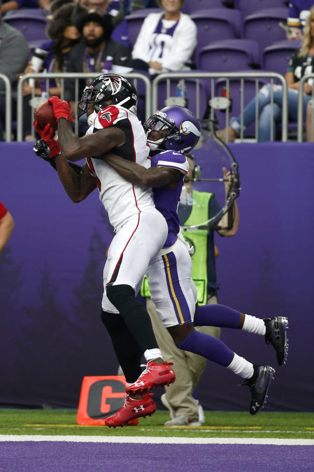 Atlanta Falcons wide receiver Julio Jones catches a 2-yard touchdown pass ahead of Minnesota Vikings cornerback Mark Fields, right, during the second half of an NFL football game Sunday, Sept. 8, 2019, in Minneapolis. (AP Photo/Bruce Kluckhohn)