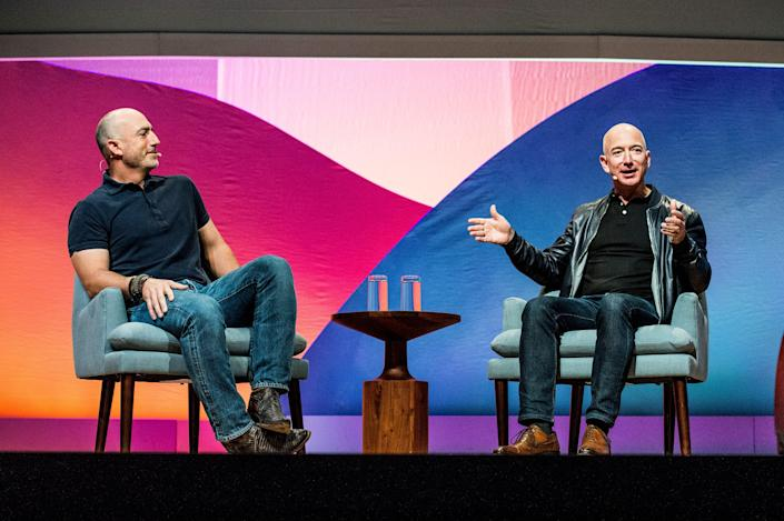 Mark Bezos, left, and Jeff Bezos seen on day two of Summit LA17 in Downtown Los Angeles's Historic Broadway Theater District on Saturday, Nov. 4, 2017, in Los Angeles.