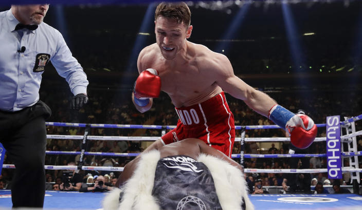 FILE - In this Saturday, June 1, 2019 file photo, England's Callum Smith, above, knocks down Hassan N'Dam, of France, during the first round of a super middleweight championship boxing match in New York. Smith will compete in the biggest fight of his career on Saturday, Dec. 19, 2020 when attempts to do what just one man, the great Floyd Mayweather, has achieved -- beat Canelo Alvarez, a four-division world champion who, for many, is the best pound-for-pound boxer around. (AP Photo/Frank Franklin II, File)