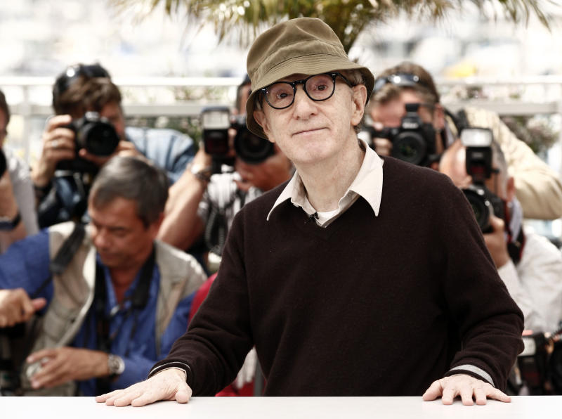 """FILE - In this May 15, 2010 file photo, filmmaker Woody Allen poses during a photo call for the film """"You Will Meet a Tall Dark Stranger,"""" at the 63rd international film festival, in Cannes, southern France. Allen is busy preparing his latest movie, """"Magic in the Moonlight."""" Continuing his European intrigue, Allen's upcoming film, which is set in southern France and has already begun production, and stars Colin Firth, Emma Stone, Eileen Atkins, Marcia Gay Harden, Hamish Linklater, Simon McBurney, and Jacki Weaver. (AP Photo/Matt Sayles, file)"""