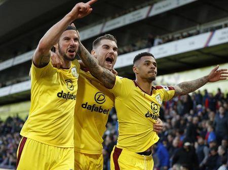 Burnley's Andre Gray celebrates scoring their second goal with George Boyd and Sam Vokes