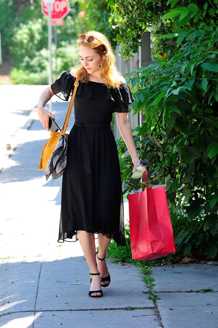 AnnaSophia Robb spotted in an Express Off The Shoulder Midi Dress while running errands in LA.