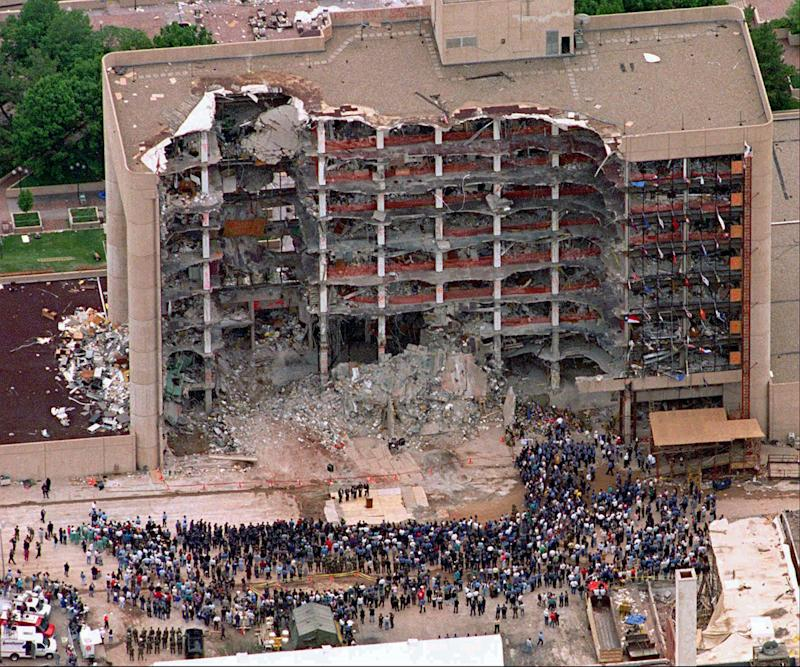 A large group of search and rescue crew attends a memorial service in front of the Alfred P. Murrah Federal Building in Oklahoma City on May 5, 1995. The blast killed 168 people _ including 19 children _ injured hundreds more and caused hundreds of millions of dollars in damage to structures and vehicles in the downtown area. (Photo: Bill Waugh/AP)