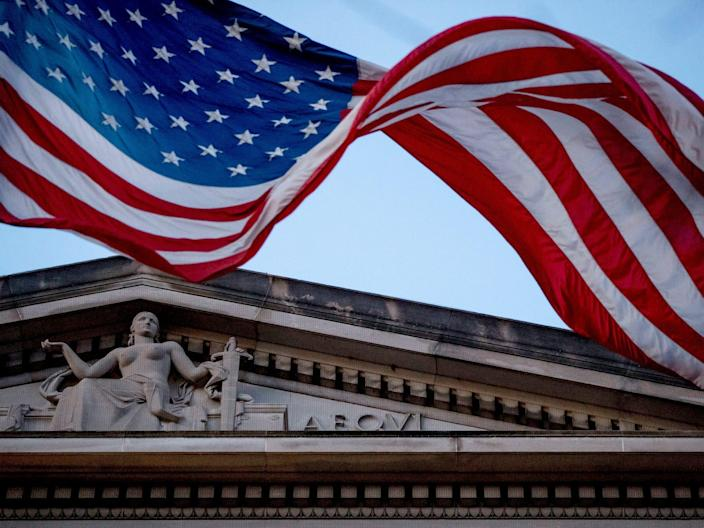 "An American flag flies outside the Department of Justice in Washington in March 2019. <p class=""copyright"">Andrew Harnik/AP</p>"