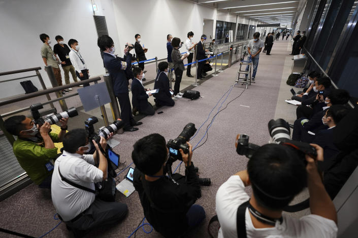 Yuki Kitazumi, a Japanese freelance journalist detained by security forces in Myanmar in mid-April and accused of spreading fake news criticizing the military coup, speaks to media as he arrived at Narita International Airport, in Narita, east of Tokyo. (AP Photo/Eugene Hoshiko)