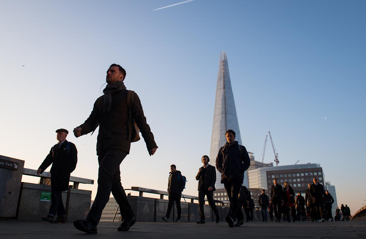 Commuters cross London Bridge, in central London, as Britain could experience more record-breaking temperatures this week.