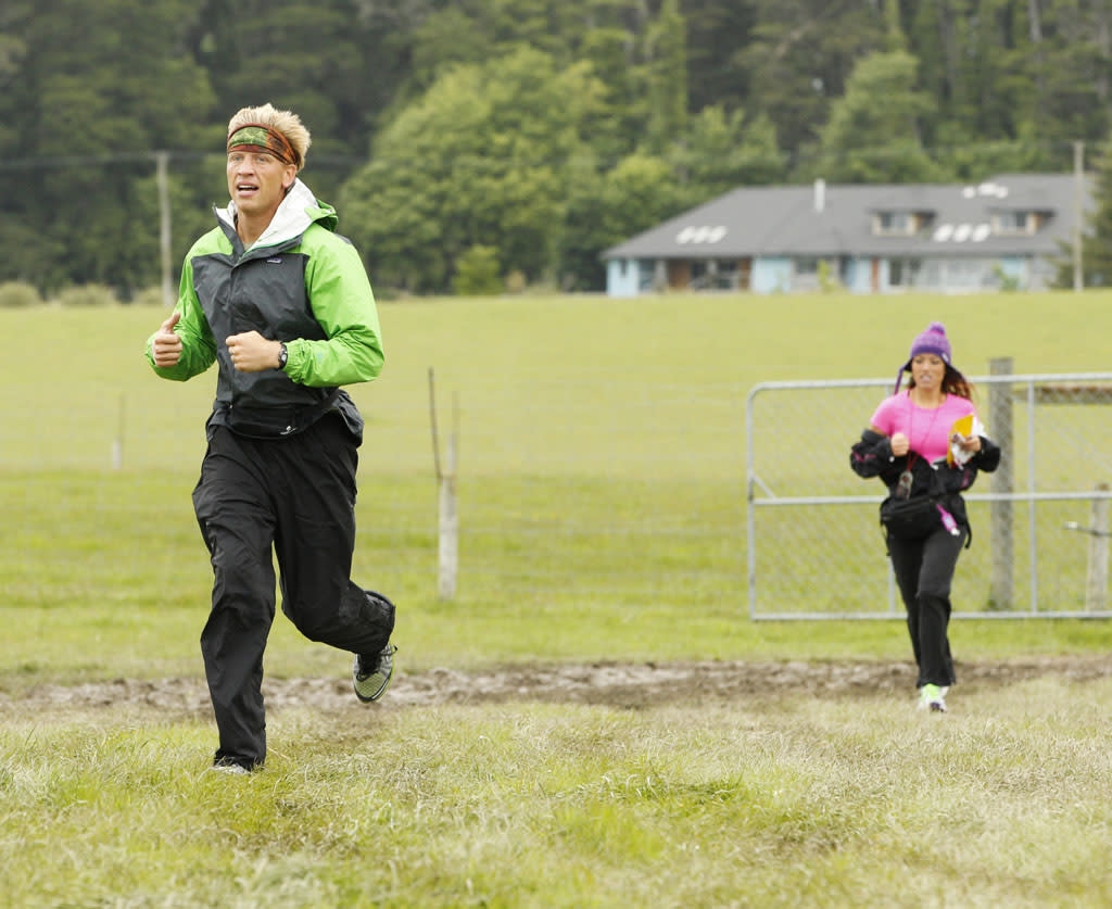 """Like James Bond Again"" -- In this Road Block, Dating couple John (left) and Jessica (right) must participate in a Shemozzle Race which requires one team member to dress as a Kiwi sheperd and run through a wild obstacle course while collecting eggs. Once they deliver all their unbroken eggs to the finish like, they will receive the next clue, on ""The Amazing Race."""