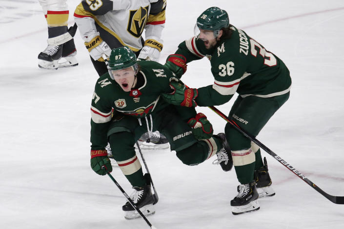 Minnesota Wild left wing Kirill Kaprizov (97) celebrates his goal with right wing Mats Zuccarello (36) during the third period against the Vegas Golden Knights in an NHL hockey game Wednesday, May 5, 2021, in St. Paul, Minn. The Golden Knights won 3-2 in overtime. (AP Photo/Andy Clayton-King)