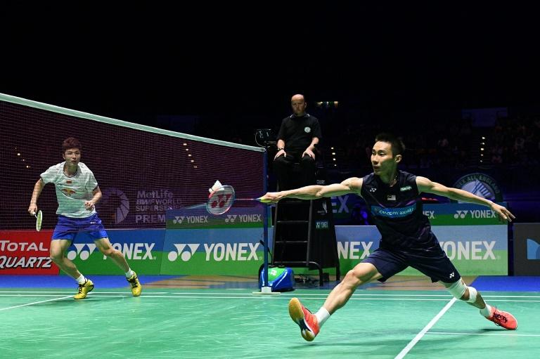 Malaysia's Lee Chong Wei (R) returns to China's Lin Dan during their All England Open Badminton Championships men's singles final match in Birmingham, central England, on March 12, 2017