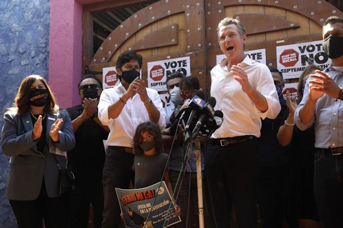EAST LOS ANGELES, CA - AUGUST 14, 2021 - -California Gov. Gavin Newsom makes a statement against his recall while meeting with Latino leaders at Hecho en Mexico restaurant in East Los Angeles on August 14, 2021. Governor Newsom met with volunteers who were working the phone banks calling voters to vote against the recall at the restaurant. Los Angeles City Councilman Kevin de Leon, California, California Assemblyman Miguel Santiago, California State Senator Maria Elena Durazo and other dignitaries were on hand to support the governor. (Genaro Molina / Los Angeles Times)