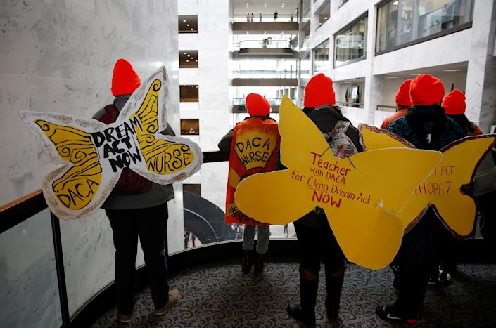 <p>Protesters calling for an immigration bill addressing the so-called Dreamers, young adults who were brought to the United States as children, walk through the Hart Office Building on Capitol Hill in Washington, Jan. 16, 2018. (Photo: Joshua Roberts/Reuters) </p>