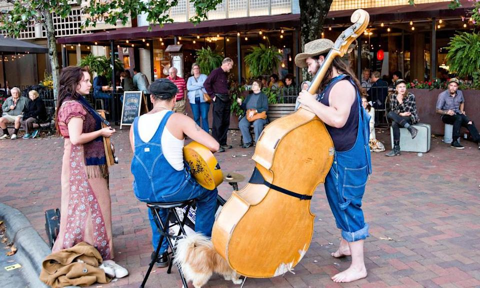 Street musicians busk in Asheville, North Carolina.