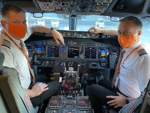 Sunwing pilots in the cockpit of Sunwing Airline's first returning flight to Punta Cana since March.