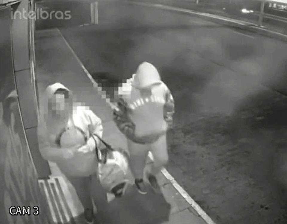 CCTV shows the mother of Miguel Rodrigues dos Santos with her lover, with a duffle bag in the streets of Imbe. Source: Newsflash/Australscope