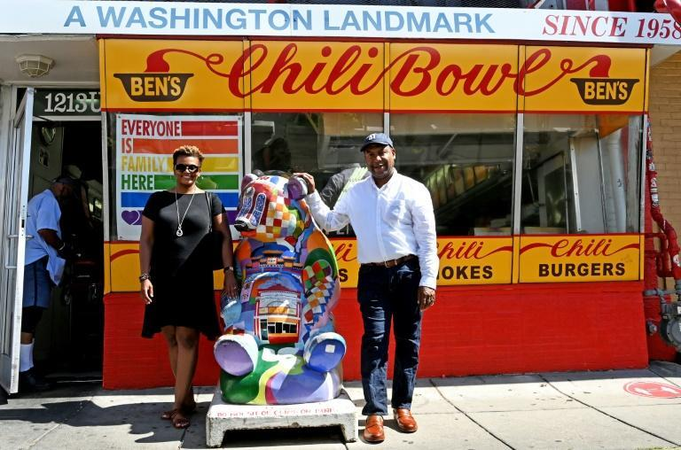 Erinn Tucker and Furard Tate, pictured in front of Washington-based Ben's Chili Bowl, were united by a shared mission of spreading awareness of Black excellence in cooking
