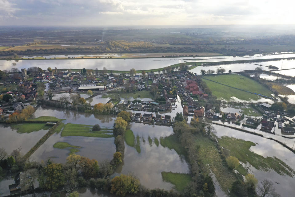 A general view of flooded homes in the village of Fishlake, South Yorkshire, England, Wednesday, Nov. 13, 2019. British Prime Minister Boris Johnson has received a frosty reception in flood-hit areas of northern England after victims of torrential rains lashed out at his slow response in coming to survey the damage.(Richard McCarthy/PA via AP)