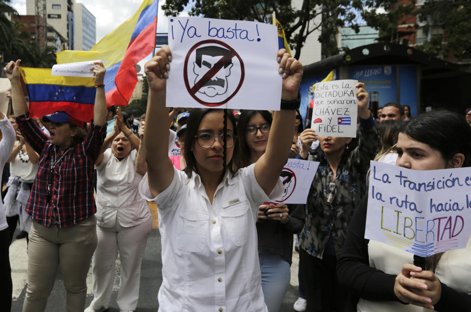 A woman protests against the blocking of supplies to Venezuela. Source: AP