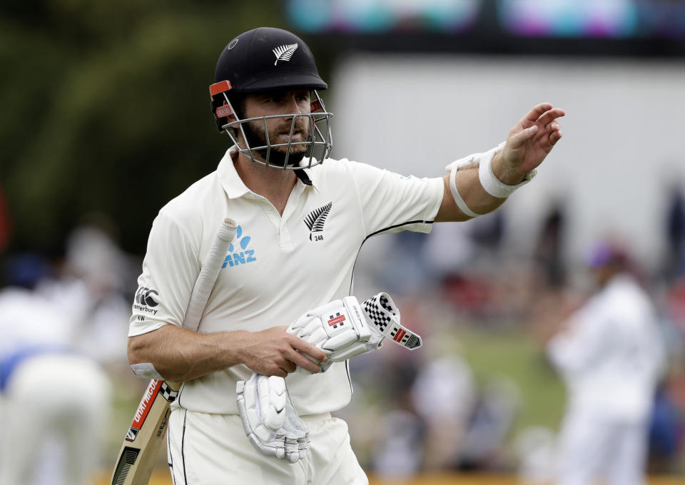 FILE - In this March 2, 2020, file photo, New Zealand's Kane Williamson reacts as he leaves the field after he was dismissed for five runs during play on day three of the second cricket test between New Zealand and India at Hagley Oval in Christchurch, New Zealand. New Zealand has named a 20-man squad for two tests in England in June. (AP Photo/Mark Baker, File)