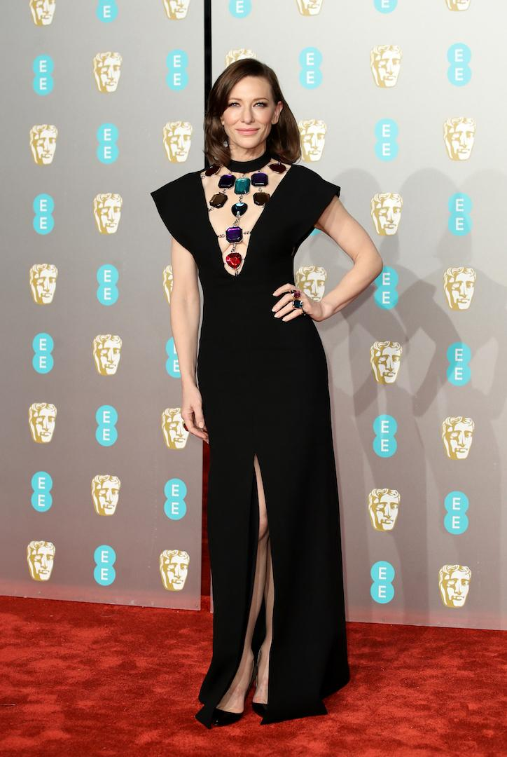 Proving you don't need a frock to win over the fash pack, Cate Blanchett chose a slick Christopher Kane jumpsuit and co-ordinating Sergio Rossi shoes for the 2019 BAFTAs. [Photo: Getty]