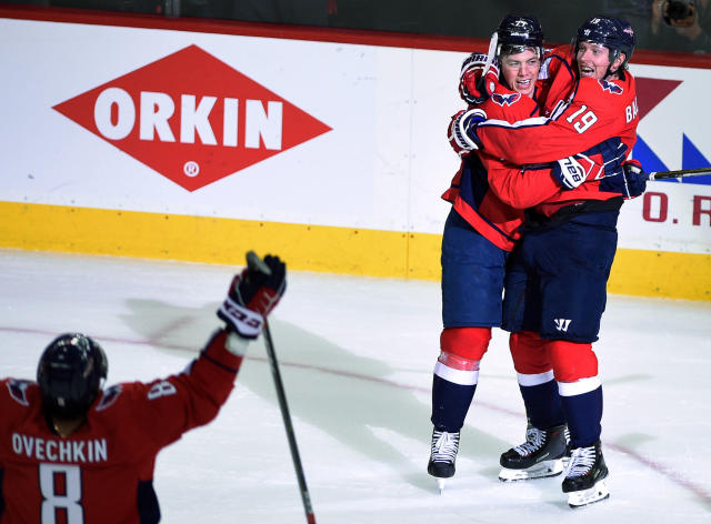 Washington Capitals right wing T.J. Oshie, center, celebrates his goal with Nicklas Backstrom (19), of Sweden, and left wing Alex Ovechkin (8), of Russia, during the third period in Game 2 of an NHL first-round hockey playoff series against the Columbus Blue Jackets, Sunday, April 15, 2018, in Washington. (AP Photo/Nick Wass)