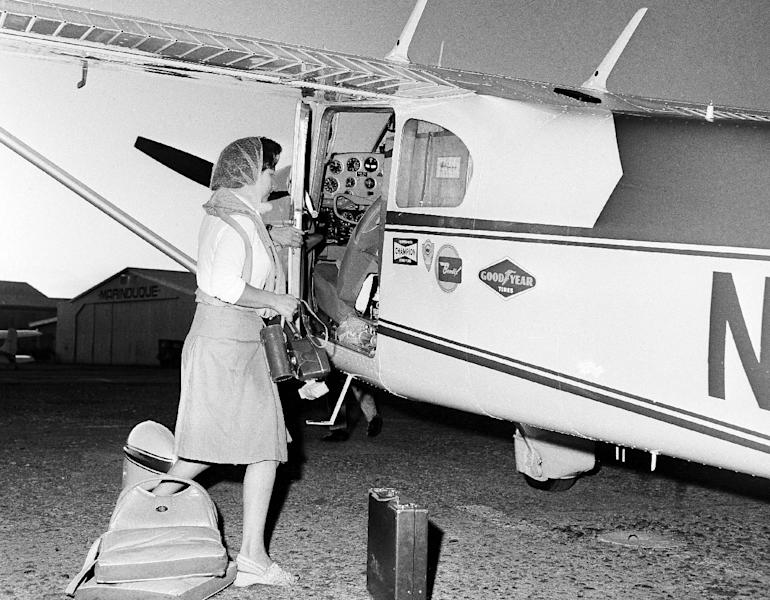 FILE - This photo made in November, 1964, shows Jerrie Mock preparing to board her single-engine propeller plane at Manila Airport, on her way for Guam during a solo flight around the world. Fifty years ago Mock became the first woman to fly solo around the world. (AP Photo/Marcelino Roxas)