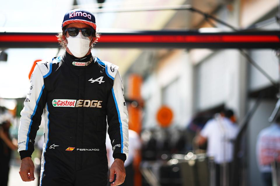 SPIELBERG, AUSTRIA - JULY 03: Fernando Alonso of Spain and Alpine F1 Team walks in the Pitlane during qualifying ahead of the F1 Grand Prix of Austria at Red Bull Ring on July 03, 2021 in Spielberg, Austria. (Photo by Mark Thompson/Getty Images)